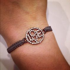 I'm just in love with this LOVE rhinestone bracelet from Around My Wrist. $ 12.95, via Etsy.