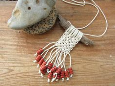 While on the beach, I collected drift wood and made macrame necklaces. The necklaces are all totally one of a kind and the string used is repurposed candle wicking! For this one, I added reddish, orange wooden beads to the string ends.