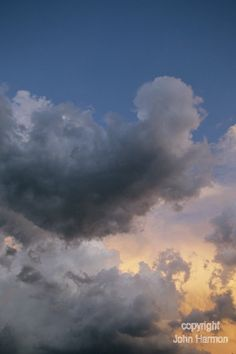 An Angel Shaped  Cloud Ascending above a by JohnHarmonGallery