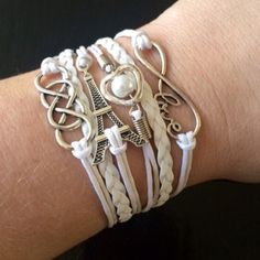 "White Paris, Infinity, Love Wrap Bracelet Love Paris? Here is your bracelet! A beautiful white wrap bracelet with a Eiffeltower charm, a love infinity charm and a faux pearl. The bracelet measures 7"" long and had a 2"" extension. KSAR Jewels Jewelry Bracelets"