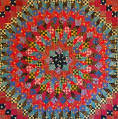 The Third Wish: Wheel of Fortune Quilt by Diane Folks. 8 years in the making. This design is on the cover of Kaffe Fassett's 'Caravan of Quilts'