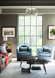 Located in the former kitchen, the study was painted gray to give it a cozier, more masculine feel.