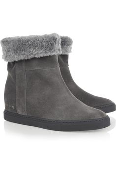 Concealed wedge heel measures approximately 75mm/ 3 inches with a 25mm/ 1 inch sole Dark-gray suede and faux shearling Pull on