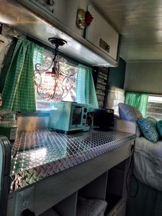 Vintage camper, transformed into an amazing beautiful bedroom for guests.