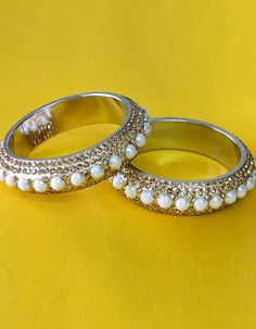 #Bangles, #Bracelets & #Kadas - Golden Pearl & Stone Studded Bangles Costs Rs. 550. #Jewellery. BUY it here: http://www.artisangilt.com/jewellery/bangles-bracelets-kadas/golden-pearl-stone-studded-bangles.html?ref=pin