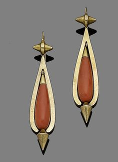 A late 19th century pair of gold and coral pendent earrings  Each coral, corallium rubrum, drop, capped and suspending gold finials, within further gold surround, length 6.0cm