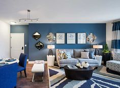 Model apartment featuring wood style flooring in living/dining areas, kitchens & entries, ceiling fans in living rooms, 2-panel arch top interior doors, and spacious patios and balconies at AMLI Spanish Hills, luxury Camarillo apartments.