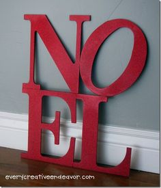 NOEL - wood letters, glue together, spray painted red, then add glitter