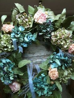 dried everlastings wreath of hydrangea, pink peony and lavender bundles tied in lavender french organza ribbon.
