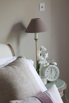 Farrow + Ball Elephants Breath paint in bedroom. Fabrics from fox linton and gp & j baker.