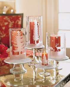 These glittered candleholders are elevated on glass cake stands, then dusted with faux snow.