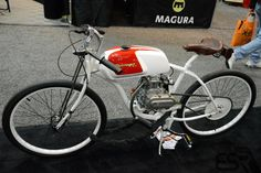 The Derringer Gas Bespoke's are custom bikes as the name would suggest. They are modern interpretations of the board track racing motorcycles of the 1920s. As seen at the Indianapolis Motorcycle Show and Trade Expo in february 2013.