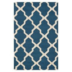 Featuring a trellis motif and navy and ivory palette, this hand-tufted wool rug makes the perfect addition to your living room or master suite.