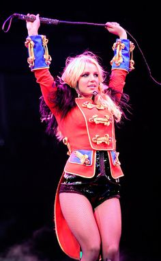 """The Ringleader from Britney Spears' Best Concert Costumes  When the tour is called """"The Circus Starring Britney Spears,"""" you're guaranteed to get a Circus-themed outfit. This traditional ringleader coat gets a sexy Britney twist: No pants! It's all the rage in pop music these days."""