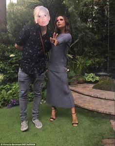 Great time! Victoria Beckham showed the laughs behind the glare as she enjoyed some silly downtime with her eldest son Brooklyn - who sported a mask adorned with his mother's face