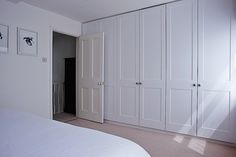 Wall of built-in closets in master bedroom of Isabel and George Blunden London renovation | Remodelista