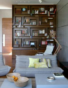 I wonder whether I could transform my awkward bookcase into something like this!