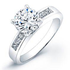Solitaire with channel set princess cut diamond shoulders