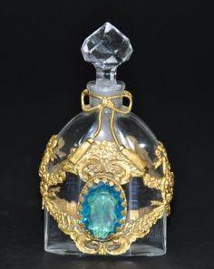 A 19th century glass gilt bronze perfume bottle