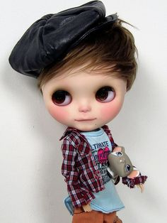 Blythe Boy I love her BiG EyEs!! Blythe is a fashion doll, about (11 inch) tall, with an oversized head and large eyes that change color with the pull of a string. It was created in 1972 and was initially only sold for one year in the USA by toy company Kenner. In 2000 the photo book This is Blythe was published and in 2001 the Japanese toy company Takara began producing new editions of Blythe dolls. There is a network of hobbyists who customize the doll for resale and create clothing and…