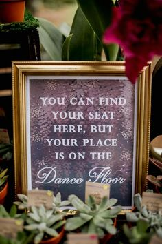 """Fun wedding sign idea - escort card sign idea - gold-framed sign with """"you can find your seat here, but your place is on the dance floor."""" {Alisa Sue Photography}"""
