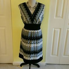 Rabbit Designs dress Gray, white and black patterned dress.  Lined.  100% polyester .  Sleeveless with black band at waist.  Simply beautiful.  NWOT. Rabbit  Rabbit  Rabbit  Designs Dresses