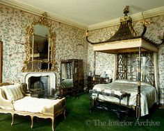 Here we have a 17th century Chinoiserie style bedroom featuring Chinoiserie style wallpaper. You can really see the French come out in this room with the day bed adding luxury. This room is inspiring by the dark green carpet and the details around the mirror and bed especially keeping it in culture.