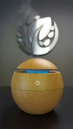 The new EB-Orb Aroma Humidifier in action. Holds 130ml of water and has a run time of 5 hours. Available in light and dark wood. Available for 20% Off right now at www.essentialbracelet.com. #essentialoils #youngliving #doterra #aromatherapy 5 Hours, Humidifier, Dark Wood, Doterra, Light In The Dark, Aromatherapy, Essential Oils, Action, Bracelet