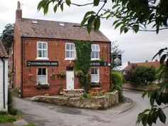 The Goodmanham Arms, Goodmanham, Market  Weighton, Yorkshire - The Goodmanham Arms is in the middle of a village of whitewashed cottages and is a simple red brick pub, but inside is another story