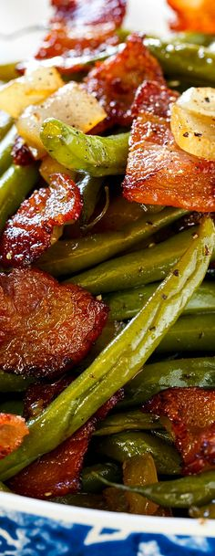 Green beans cooked with lots of bacon and onion and coated in a sweet, salty, and sour sauce make one of the best side dishes ever.
