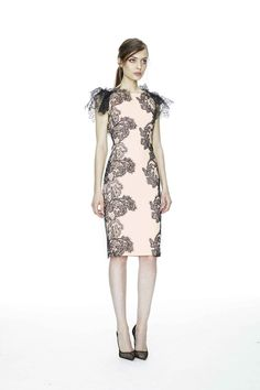 Resort 2015: This is a blush pink cocktail dress with black floral detail on both sides of the dress and lace ruffle short sleeves. What an elegant dress! I love the floral detail on the sides which is not only exquisite but slimming.