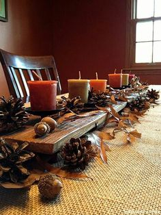 Love this!! Weathered plank as table runner!! Need some new candles anyway.. Pine cones leaves fall autumn thanksgiving decor