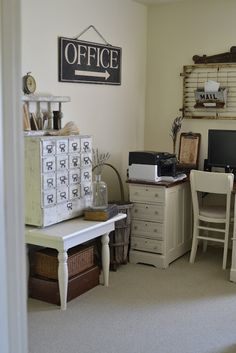 A cute 'office vignette'...  things that stood out to me were the file drawer cabinet with  the spindle file holder sitting on top... and the bed frame bulletin board with the chicken feeder mail box (and not showing were memos, pics, etc secured with clothespins..)      sooo primly functional!     :)