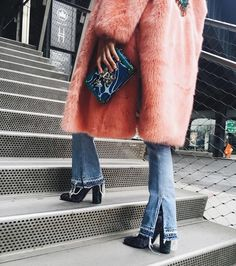 This long pink furry trench coat is too much for me too handle! I love it paired with these bell bottom jeans and heel boots. Such a killer outfit!