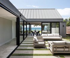 Why this Waiheke Island holiday home doesn't draw attention to itself Contemporary Beach House, Cedar Cladding, Waiheke Island, Timber Door, Storey Homes, The Gables, Big Windows, Window Design, House Tours