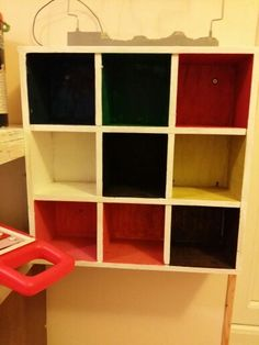 Recycled square shelving made into colour sorting shelf for the kids!