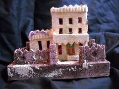 """Late 1920s Lg Japanese Putz (Coconut-shredded mica) Castle (5 1/2'w x 4""""d x 4 1/2""""h)-Nice heavy mica snow-great colors- some wear to due to age and use throughout the years. The original price is in pencil on the bottom 19 cents."""