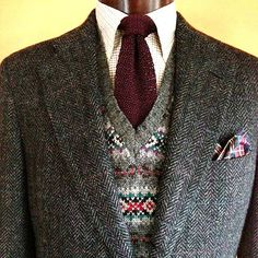 A very unique windowpane herringbone tweed by Harold Powell with timeless fair isle sweater vest. Polo tattersall button-down and knitted silk tie. Visit us on-line for details. oldengrey.com