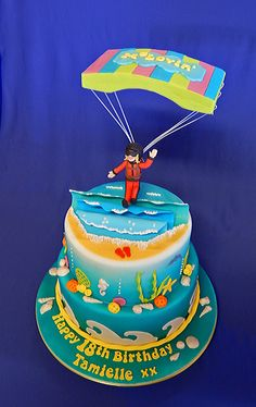 Parachuting Birthday Cake White chocolate and raspberry mud cake, filled with ganache, iced with fondant and airbrushed with colour. Teacher Appreciation Gifts, Teacher Gifts, Mouse A Cookie, The Giving Tree, Mud Cake, Pokemon Birthday, Wine Bottle Labels, Themed Cakes, Parachuting