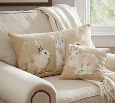 Watercolor Bunny Pillow | Pottery Barn  I like both pillows bigger and this one, I would want the set, but they are kinda pricey, so maybe if they were on sale or something.