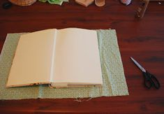 As mentioned, I am borderline-obsessed with covering photo albums in fabric. This little how-to represents the first time I've used regula...
