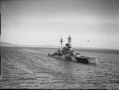 HMS Royal Sovereign was a Revenge-class battleship of the British Royal Navy. Seen here in camouflage pattern.