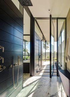 Materials + door - indoor/outdoor shower  SK RANCH - Lake Flato Architects
