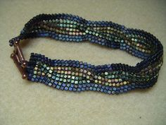 Made this for Mum using 2mm cube beads and Ndebele herringbone stitch with a cable twist!