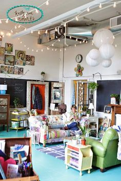 Kelly Rae studio. Very full, colorful, and eclectic studio that includes a lounge spot for guests.