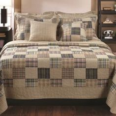 """Transform your master suite or guest bedroom with this charming cotton quilt set, featuring a multicolor floral motif and fabric-bound edges.    Product:    Twin: Quilt and 1 standard sham    Full/Queen: Quiltand 2 standard shams   King: Quiltand 2 king shams   Construction Material: CottonColor: MultiFeatures:  Oversized for better mattress coverageMulticolor patchwork face reverses to an all-over neutral plaid back Dimensions: Standard Sham: 20"""" x 26"""" eachKing Sham: 20"""" x 36"""" eachTwin…"""
