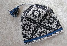 Tasseled Inga Hat - When I make this I am going to attach more than one tassel.  The one tassel on this hat looks kind of lonely and in need of a friend.
