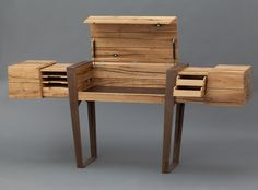 I just deemed this style, 'Primitive Modern'... 'Simon Schacht's Secretary Desk' (Opened Up), when closed it conceals writing center + compartments and doubles as a sleek rustic modernest timber table...