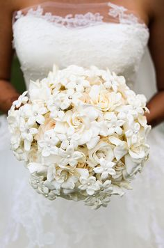 Fabulous white stephanotis blooms are punctuated with pearl pins, adding a romantic touch to this all-white wedding bouquet.