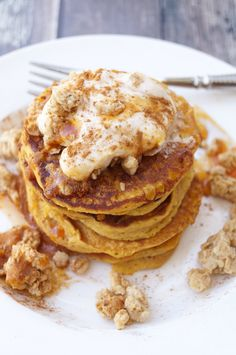 These Pumpkin Pancakes with Gingersnap Granola and Pumpkin Spice Yogurt Topping are the epitome of a filling and delicious fall breakfast!